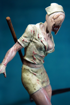 silent hill 2 head nurse with a scythe